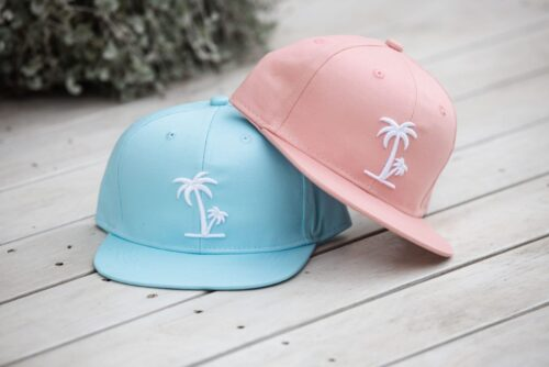 Featuring the blue & peach palm tree caps